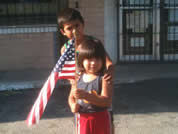 migrant kids with American flag